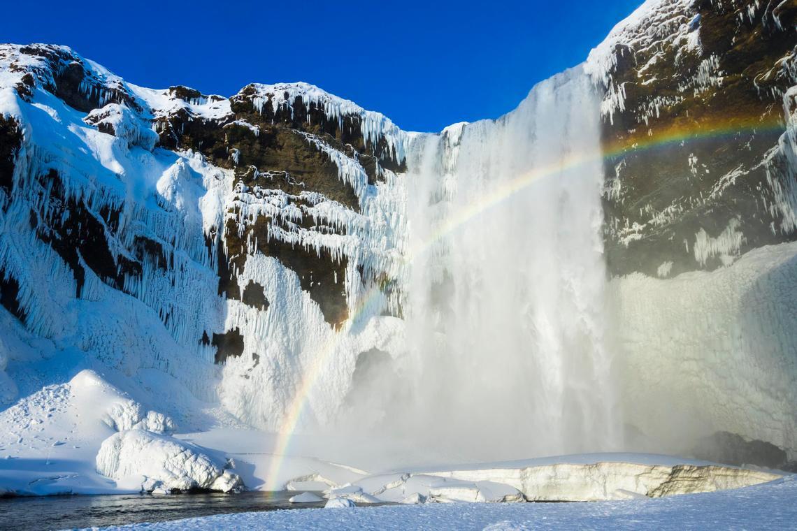 wodospad Skogafoss, śnieg, tęcza, fotowyprawa Islandia zima